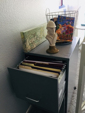 File cabinet with rejection letters, notes from writing workshops, inspirational items for my boards